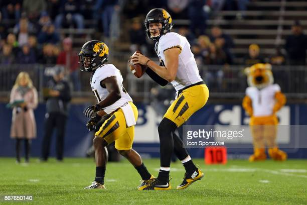 Missouri Tigers quarterback Drew Lock looks to throw during a college football game between Missouri Tigers and UConn Huskies on October 28 at...