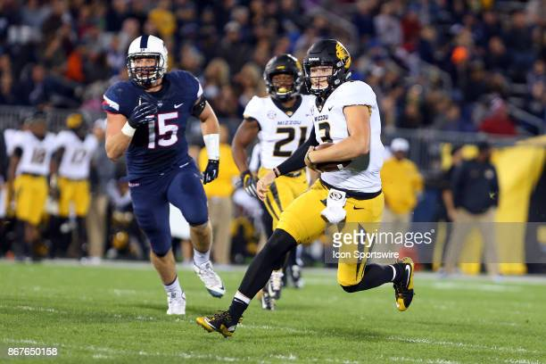 Missouri Tigers quarterback Drew Lock scrambles during a college football game between Missouri Tigers and UConn Huskies on October 28 at Rentschler...