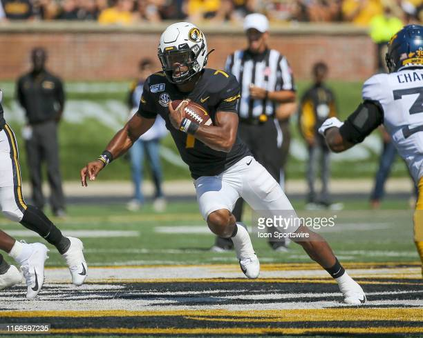 Missouri Tigers quarterback Kelly Bryant runs the ball during the first half of a NCAA college football game against the West Virginia Mountaineers...
