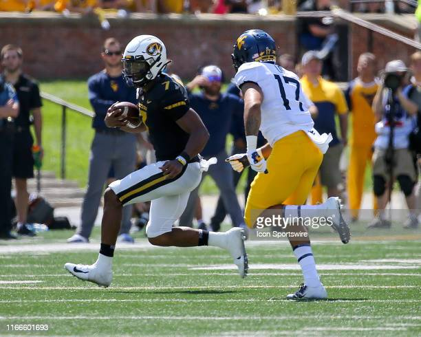Missouri Tigers quarterback Kelly Bryant runs the ball while under pressure from West Virginia Mountaineers linebacker Exree Loe during the first...
