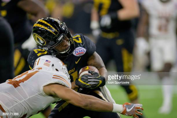 Missouri Tigers running back Ish Witter is stopped by Texas Longhorns defensive back PJ Locke III during the first half of action between Texas vs...