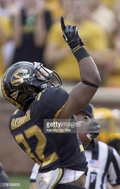Missouri Tigers running back Russell Hansbrough celebrates after scoring a touchdown in the first quarter against Murray State at Faurot Field in...