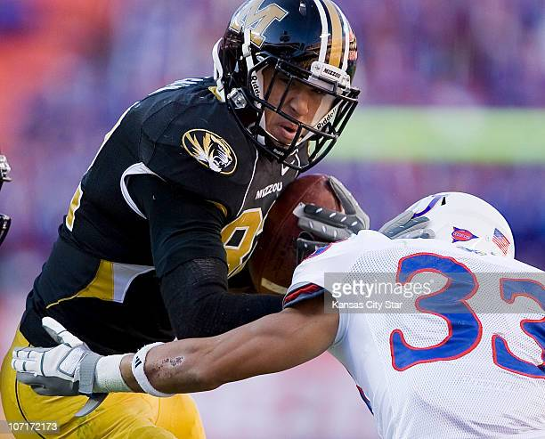 Missouri Tigers tight end Michael Egnew fought off Kansas Jayhawks cornerback Tyler Patmon while gaining yards in the fourth quarter at Arrowhead...