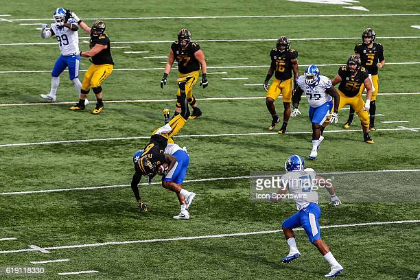 Missouri Tigers wide receiver J'Mon Moore is upended on a tackle after making a reception from Missouri Tigers quarterback Drew Lock during a NCAA...