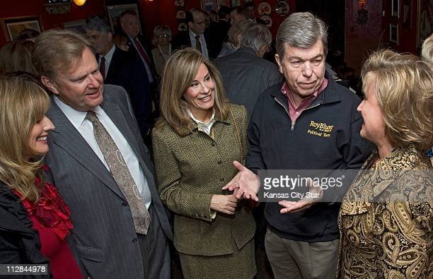 Missouri US Senate candidate Roy Blunt second from right and his wife Abby Blunt center visit with Ann Wagner right chairman of the Blunt for Senate...