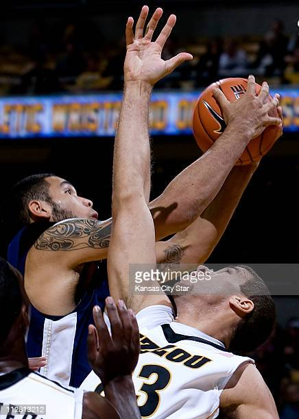 Missouri's Justin Safford right battles Oral Roberts' Damen BellHolter for a rebound during the opening half at Mizzou Arena in Columbia Missouri on...