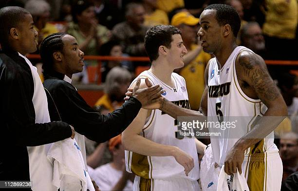 Missouri's Kim English Marcus Denmon Matt Lawrence and Leo Lyons celebrate a 7859 victory over Cornell in the first round of the 2009 NCAA Division I...