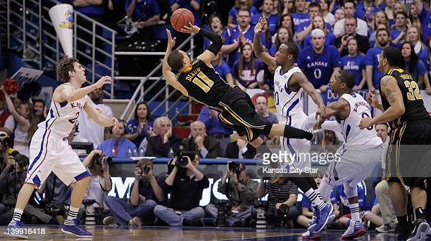 Missouri's Michael Dixon misses an offbalance shot in the second half against Kansas at Allen Fieldhouse in Lawrence Kansas on Saturday February 25...