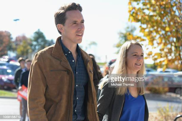 Missouri's Republican US Senate Candidate Josh Hawley arrives with his wife Erin Hawley to cast their votes on election day at The Crossings Church...