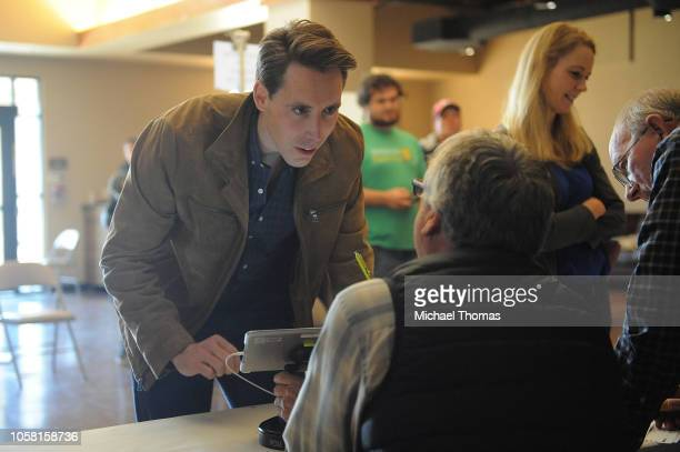 Missouri's Republican US Senate Candidate Josh Hawley checks in with an election official prior to casting his vote on election day at The Crossings...