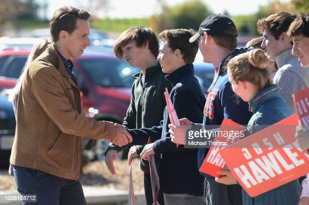 Missouri's Republican US Senate Candidate Josh Hawley greets supporters as he arrives to cast his vote on election day at The Crossings Church on...