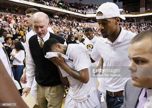 Missouri's Wes Clark leaves the court with Missouri special assistant to the Athletic Director Gary Link left and former Missouri star Kim English...