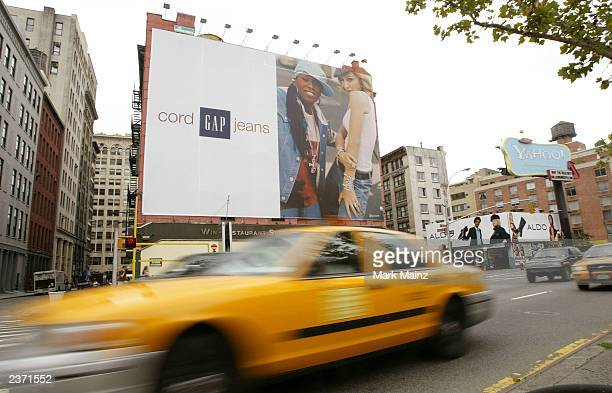 Missy Elliot and Madonna appear on a billboard at Houston Street for the Gap advertising campaign August 5 2003 in New York City