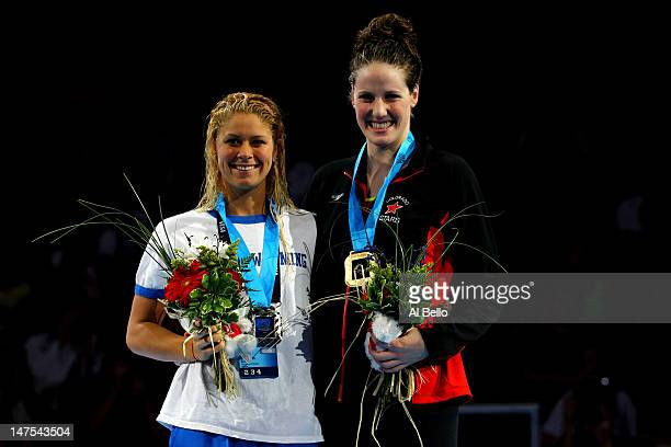 Missy Franklin and Elizabeth Beisel look on as they participate in the medal ceremony for the Women's 200 m Backstroke during Day Seven of the 2012...