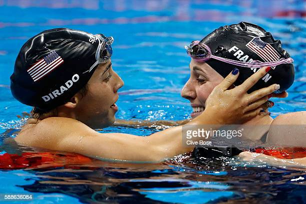 Missy Franklin of the United States embraces Madeline Dirado of the United States in the second Semifinal of the Women's 200m Backstroke on Day 6 of...
