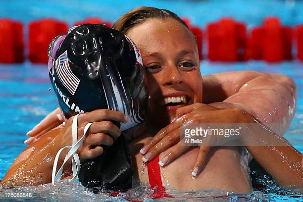 Missy Franklin of the USA is congratulated by Federica Pellegrini of Italy after the Swimming Women's 200m Freestyle Final on day twelve of the 15th...