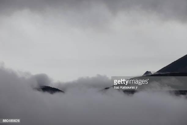Mist and cloudy sky over Naka-Dake volcano in Japan