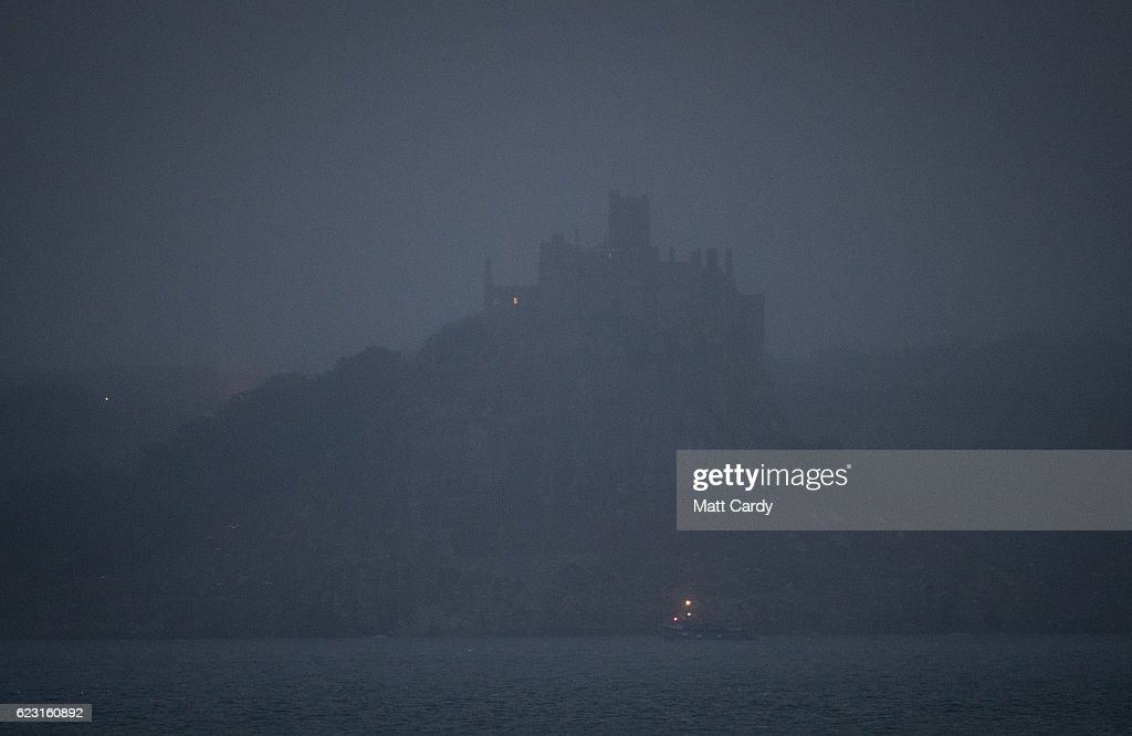 Mist and rain obscures the view of a supermoon rising behind St Michael's Mount near Penzance in Mount's Bay on November 14, 2016 in Cornwall, England. A Supermoon occurs when the perigee (closest approach by the Moon to Earth) coincides with it being full (completely illuminated by the Sun). The moon this time was expected to appear 7% larger and 15% brighter than normal. Although the next Supermoon will occur next month, the moon won't be this close to Earth again until November 2034.