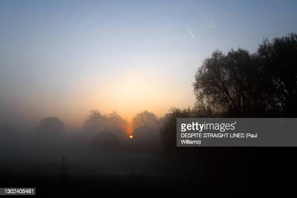 mist and the rising - sunrise dawn stock pictures, royalty-free photos & images