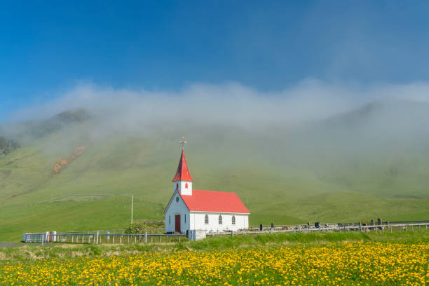 Mist around small church and cemetery, South Icelend