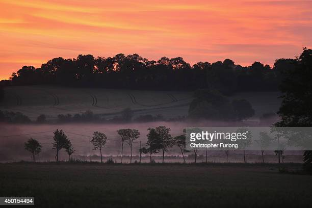 Mist clings to the Normandy countryside at dawn near Arromanche as the world commemorates the 70th Anniversary of the DDay Landings on June 6 2014 in...