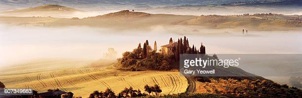 Mist covered rolling Tuscan landscape