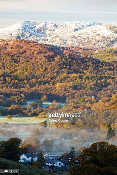 mist in ambleside, lake district, uk, looking towards wetherlam. - loughrigg fells - fotografias e filmes do acervo