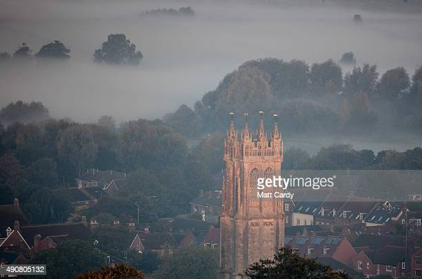 Mist lingers in fields in Somerset as the sun rises on October 1 2015 in Glastonbury England The fine autumn weather that some parts of the UK have...