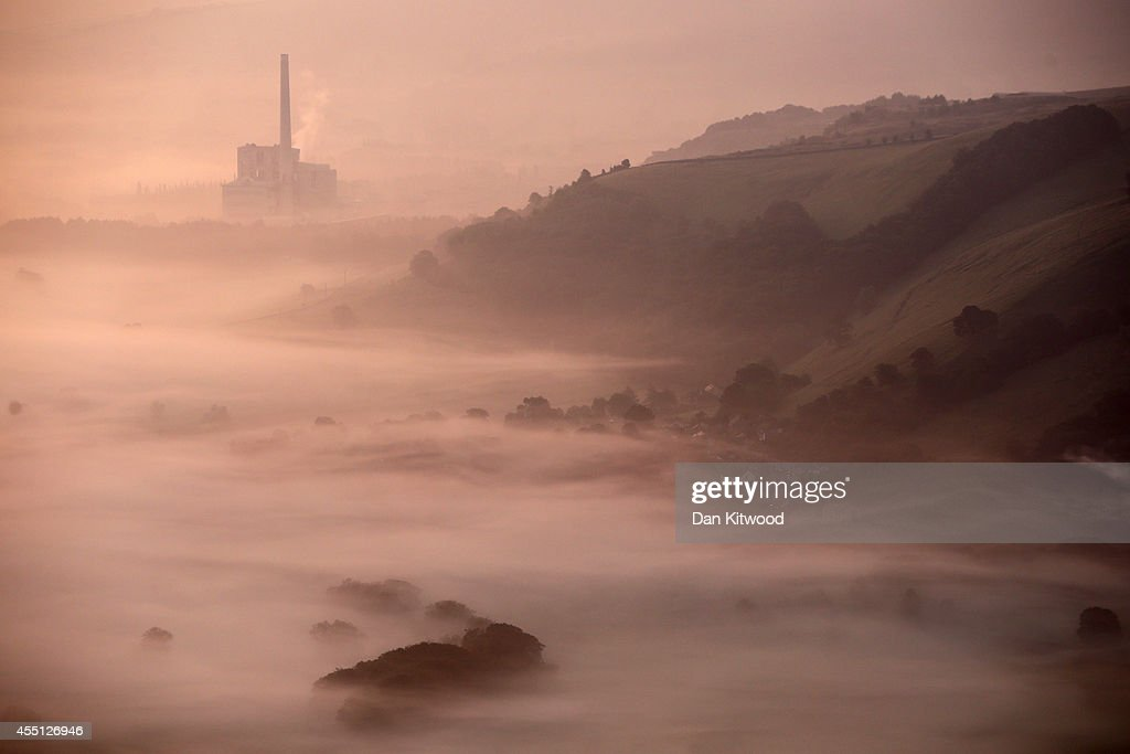Mist lingers in Hope Valley at sunrise viewed from the top of Mam Tor in the Peak District on September 10, 2014 in Castleton, United Kingdom. Much of the UK continues to enjoy mild Autumn weather with sunshine set to last for the next few days.