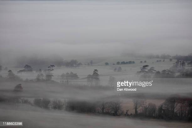 Mist lingers in the valley below Firle Beacon in the South Downs on November 19 2019 in Lewes England The UK experienced the coldest night of the...