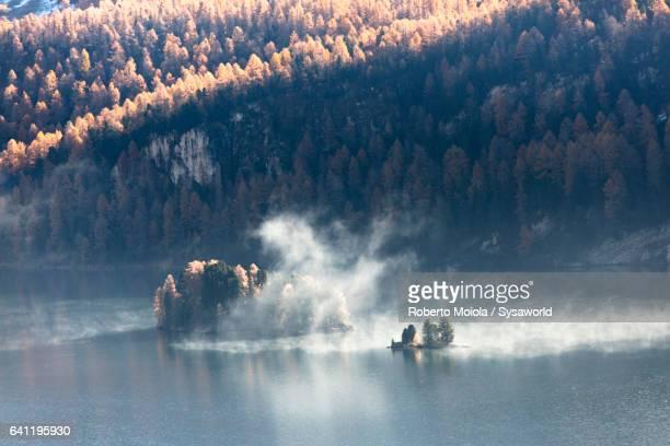 Mist on blue lake Sils Switzerland