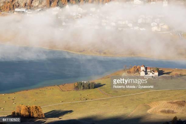 Mist on the colorful landscape Surlej Switzerland