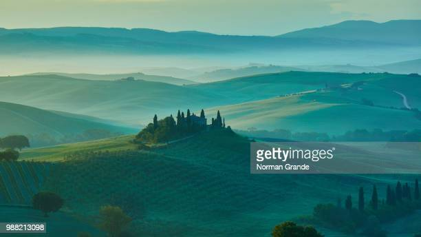 Mist over fields at sunrise in Tuscany, Italy.
