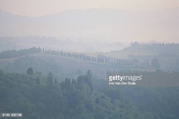 mist over hills - eric van den brulle stock pictures, royalty-free photos & images