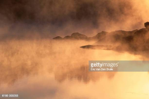 mist over lake - eric van den brulle stock pictures, royalty-free photos & images