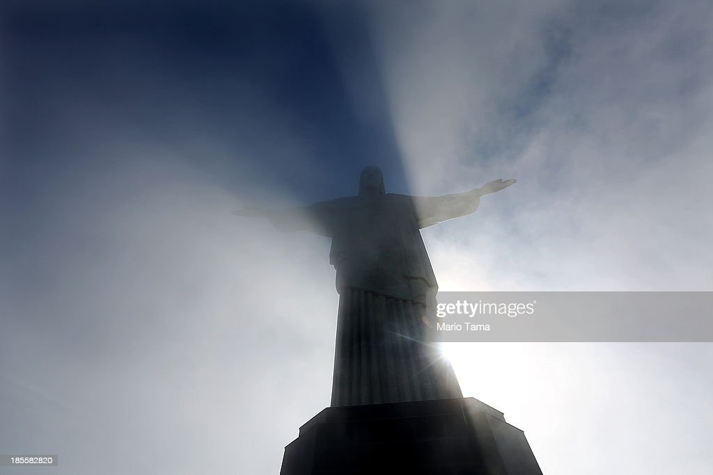 Mist passes the Christ the Redeemer statue at the summit of Corcovado on October 22, 2013 in Rio de Janeiro, Brazil. Preparations are continuing for the Rio 2016 Olympic Games along with the 2014 FIFA World Cup in Brazil.