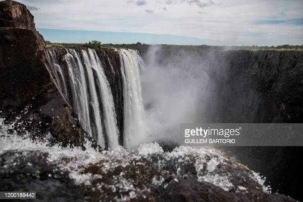 Mist rise from the gorge at the Victoria Falls in Livingstone on January 23 2020 The Victoria Falls a UNESCO world heritage site measuring 108 meters...
