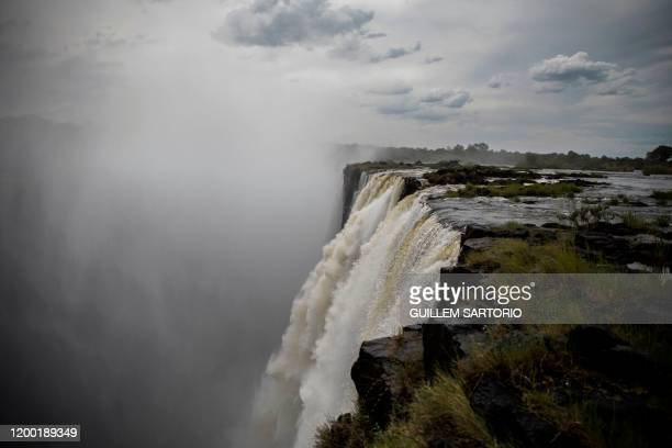 Mist rises from the gorge at the Victoria Falls in Livingstone on January 23 2020 The Victoria Falls a UNESCO world heritage site measuring 108...