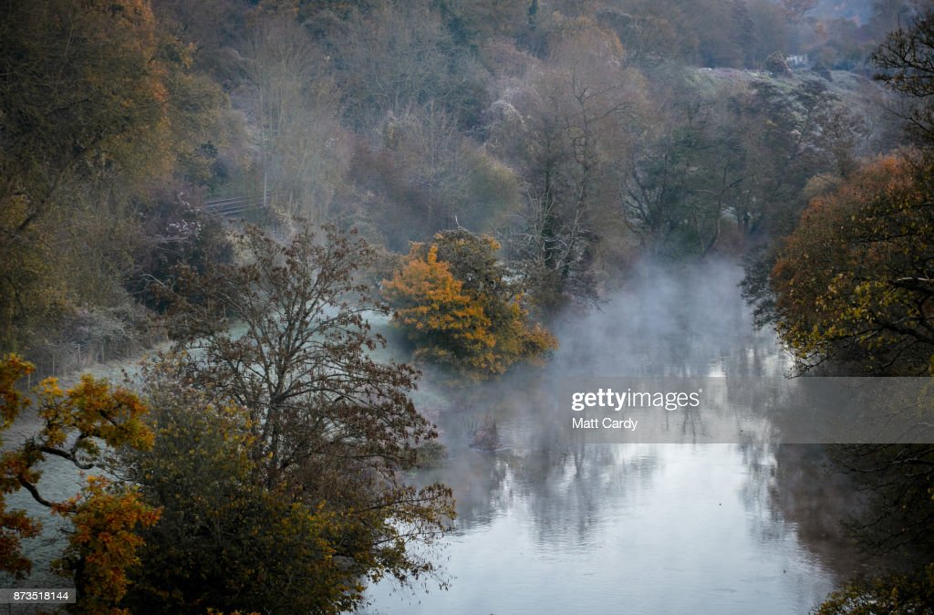 Mist rises from the River Avon viewed from the Dundas Aqueduct as the sun rises on November 13, 2017 near Bath, England. After a warm autumn, with temperatures above average, much colder weather has arrived in many parts of the UK, signalling the start of more wintery weather for the coming few weeks.