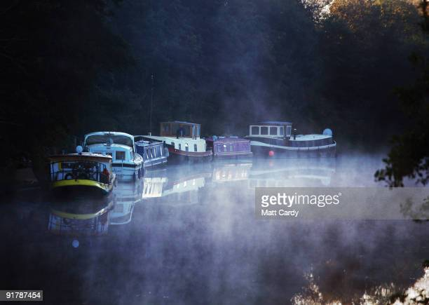 Mist rises on the River Avon below trees that are begining to change colour on October 12 2009 in Bath England England particularly in the south is...