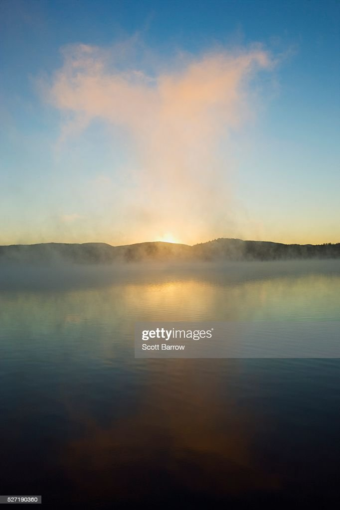 Mist rising from a lake : Stock Photo