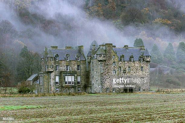 Mist rolls off the hills over Castle Menzies, just over a mile from the new home of Harry Potter creator and author JK Rowling November 29, 2001 near...
