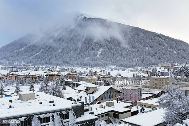 Mist sits on top of the mountain peak as snow covers commercial and residential property below in Davos Switzerland on Tuesday Jan 12 2015 Prices for...