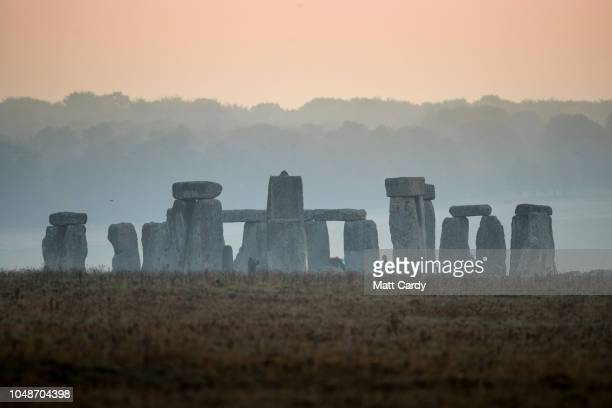 Mist surrounds the stones at Stonehenge near Salisbury as dawn breaks on October 10, 2018 in Wiltshire, England. Many parts of the UK are...