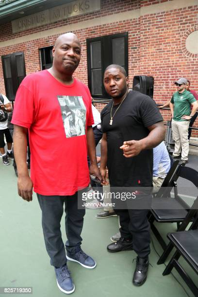 DJ Mister Cee and Lil Cease attend the ribbon cutting ceremony at Crispus Attucks Playground on August 2 2017 in the Brooklyn borough of New York...