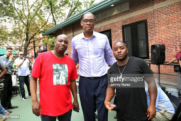 DJ Mister Cee NYC Council Member Robert E Cornegy Jr and Lil Cease attend the ribbon cutting ceremony at Crispus Attucks Playground on August 2 2017...