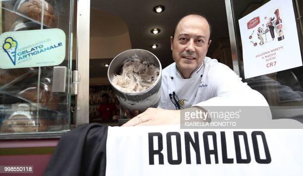 Mister Leonardo from Miretti's icecream shop in downtown Turin poses with the new icecream taste called CR7 and created for Cristiano Ronaldo's...