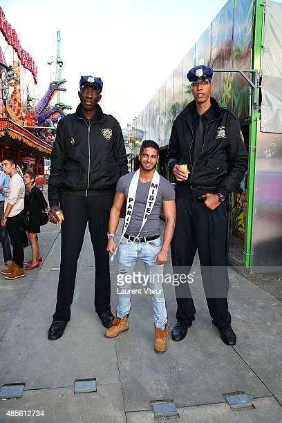 Mister Paris 2015 Yaon Curtis and Giants Policemen attend The 'Fete A Neu Neu' Opening Night To Benefit Laurette Fugain Association At Bois de...