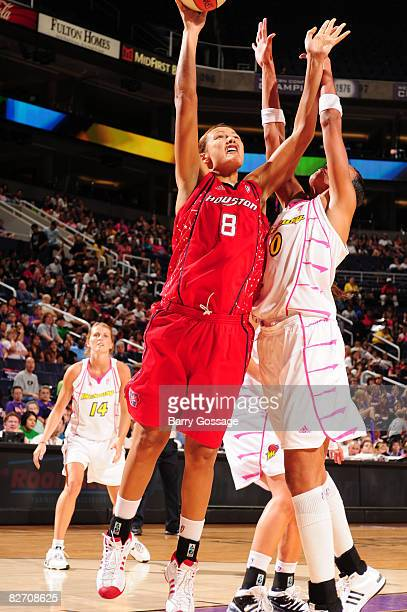 Mistie Williams of the Houston Comets shoots against Olympia Scott of the Phoenix Mercury on September 7 at US Airways Center in Phoenix Arizona NOTE...