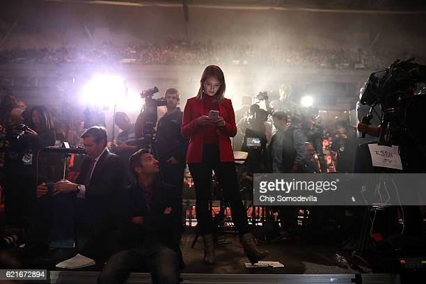 A mistproducing machine blows a steady fog onto journalists including NBC News' Katy Tur during a campaign rally with Republican presidential nominee...